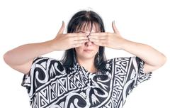 Woman covering eyes - stock photo