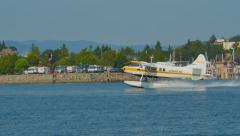 4K Float Plane Take Off, SIde Angle Zoom Shot, Water Aircraft Stock Footage