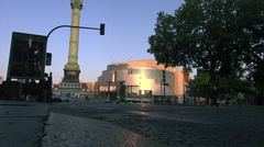 Traffic and sunset at Bastille monument and Opera in Paris, France Stock Footage