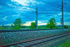 Body of a railway track with dark clouds Stock Photos