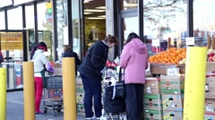 People buying fruits at Chinese Supermarket Stock Footage