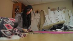 Seamstress cuts fabric. Tailoring, аpparel manufacturing - stock footage