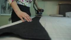 The fabric is treated with iron. Tailoring, аpparel manufacturing - stock footage