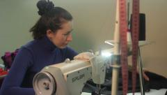 The girl seamstress works. Tailoring, аpparel manufacturing - stock footage