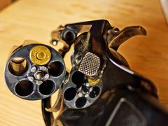 revolver with a cartridge - stock photo