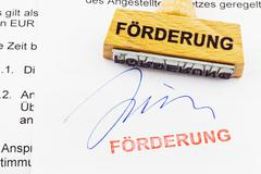 wood stamp on the document: promotion - stock photo