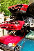 Scrap cars in a junkyard Stock Photos