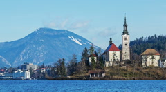 Famous church on island of lake Bled Stock Footage