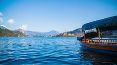 Parked boat on lake Bled Stock Footage