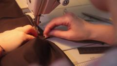 Hands seamstresses working with a sewing machine . Closeup Stock Footage