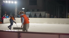 Preparing rink ice for skating at night Stock Footage
