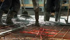 Workers pulling big hose for concreting slab of steel reinforced concrete. Stock Footage