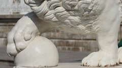 Mighty lion with ball sculpture Stock Footage