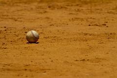 Baseball on playing field - stock photo