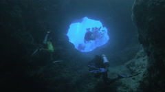 UltraHD, group of scubadivers explore underwater caves, under water shot, Palau Stock Footage