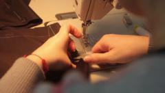 Fabric sew on the sewing machine. Tailoring, аpparel manufacturing - stock footage