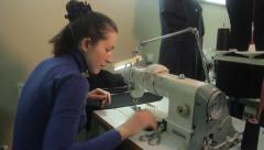 Stock Video Footage of The seamstress works with a sewing machine