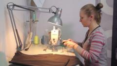 Seamstress working at the table. Tailoring, аpparel manufacturing - stock footage