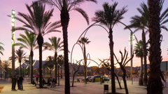 Barcelona sunset palm port vell view metal sculpure 4k time lapse spain Stock Footage