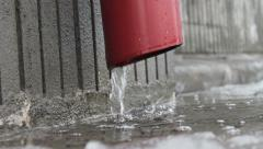 Water flows from the gutter. Spring. Stock Footage