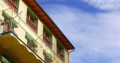 Camprodon colored house blue cloud sky 4k spain Stock Footage