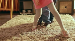 The children playing in a room, running around  the carpet Stock Footage