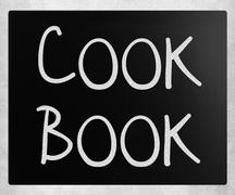 """""""Cook book"""" handwritten with white chalk on a blackboard Stock Photos"""