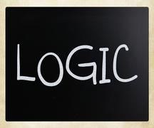 """Logic"" handwritten with white chalk on a blackboard Stock Photos"