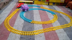 Children's toy cars and toy elephant in orbit Stock Footage