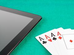 Poker cards near digital tablet pc concept of poker online Stock Photos