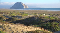 The beautiful rock at Morro Bay California in golden sunset light. Stock Footage