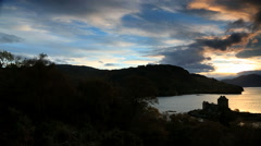 Scotland Eilean Donan Castle Loch Duich Highlands sunset coast Stock Footage