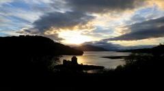 Scotland Eilean Donan Castle Loch Duich Highlands sunset coast Stock Footage