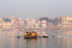 Hindu Pilgrims on Boat in the Ganges River, Varanasi, India - stock photo