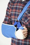 Stock Photo of Close Up Of Young Man With Arm In Sling
