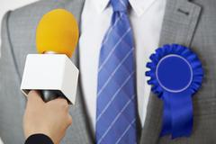 Politician Being Interviewed By Journalist During Election - stock photo