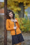 The girl with the clarinet in his hands Stock Photos