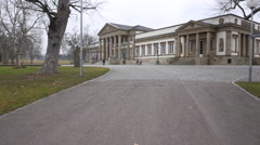 Museum from far with pan to the left Stock Footage