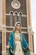 Saint Mary or the Blessed Virgin Mary, the mother of Jesus, in front of the R - stock photo