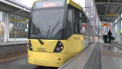 A Manchester Metrolink tram to Eccles leaving MediaCityUK, Salford, UK. Stock Footage