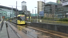 A Manchester Metrolink tram at the station close to MediaCityUK, Salford, UK. Stock Footage