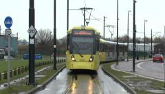 A Manchester Metrolink tram close to MediaCityUK, Salford, UK. Stock Footage