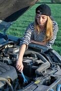 Young Blond Woman With Her Broken Car - stock photo