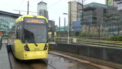 A Manchester Metrolink tram arriving at the MediaCityUK station, Salford, UK. Stock Footage