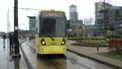 A Manchester Metrolink tram (with audio) close to MediaCityUK, Salford, UK. Stock Footage
