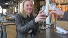 Mature blonde woman toasting wine at cafe slow motion Arkistovideo