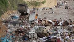 Garbage truck unloads waste on dump Stock Footage