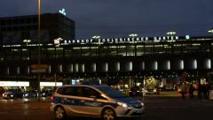 Night time traffic with police car and buss passing by at Berlin Stock Footage