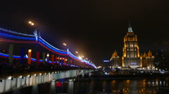 Hotel Ukraine and bridge in Moscow in the evening in winter Stock Footage