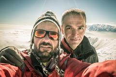 Alpinists selfie on the top Stock Photos